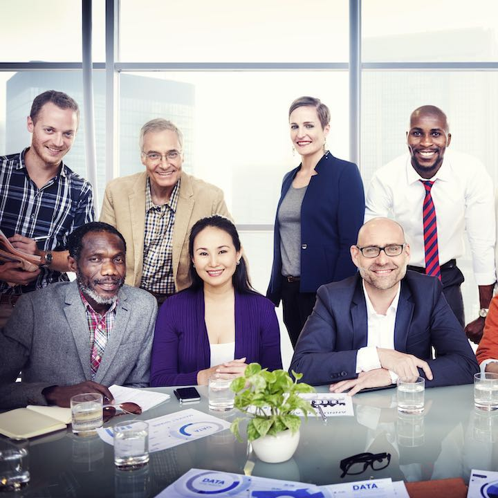 diverse group of businesspeople smiling